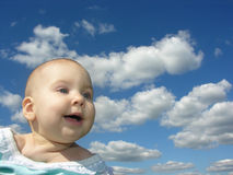 Happy Baby. Under Clouds royalty free stock photos