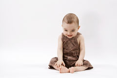 Happy baby. Curious baby on white surface Stock Images