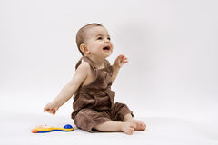 Happy baby. Curious baby on white surface Stock Photos
