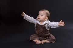 Happy baby. Curious happy baby on black surface Royalty Free Stock Image