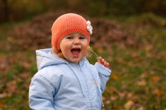 Happy baby. Girl and autumn stock photo