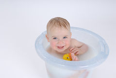 Happy baby. One year old baby is taking a bath (with milk Royalty Free Stock Images