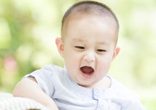 A happy baby. An Asian baby is open mouth very happily Stock Photography