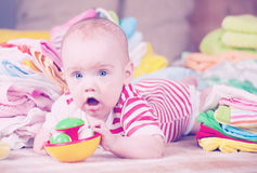 Happy baby  with  baby`s things Stock Image
