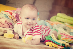 Happy baby  with  baby`s wear Stock Images