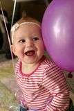 Happy Baby with Balloon. Happy 7 Month old baby girl with big pink balloon Stock Photos