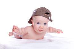 Happy baby in a baseball cap. On white background Royalty Free Stock Image