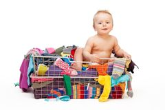 Happy baby in basket with clothes Royalty Free Stock Photos