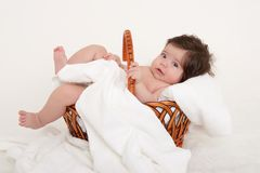 Happy baby in basket on white Royalty Free Stock Photo