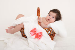 Happy baby in basket on white Royalty Free Stock Photography