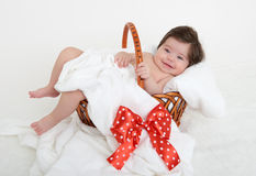 Happy baby in basket on white Stock Images
