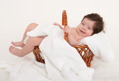 Happy baby in basket on white Stock Photos