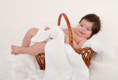 Happy baby in basket on white Royalty Free Stock Photos