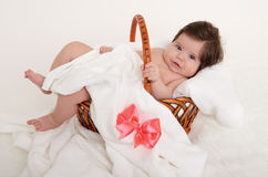 Happy baby in basket on white Royalty Free Stock Images