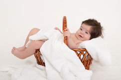 Happy baby in basket on white Stock Photo
