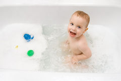 Happy baby in bath Stock Photo