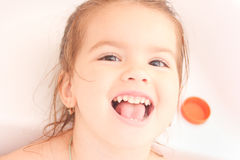 Happy baby. In the bath, swimming in the foam Royalty Free Stock Photo