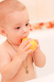 Happy baby. In the bath, swimming in the foam Stock Images