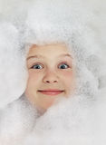 Happy baby in the bath, swimming in the foam Royalty Free Stock Images