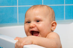 Happy baby in bathroom Stock Image
