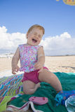 Happy baby on beach towel Stock Photo