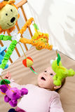 Happy baby in bed stock image