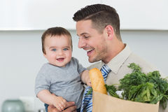 Happy baby being carried by businessman Royalty Free Stock Image