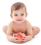 Happy baby with a big apple in her hands. Royalty Free Stock Photos