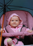 Happy baby with big umbrella Royalty Free Stock Image