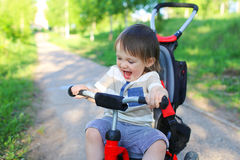 Happy baby on bike Stock Photography