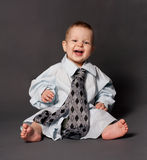 Happy baby boss wearing over sized suit Stock Photography