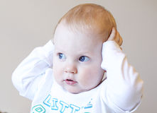 Happy baby boy. Young baby boy holding his head Royalty Free Stock Images