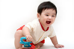 Happy baby boy. Baby boy is laughing when playing toys on white background Stock Image