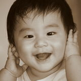 Happy baby boy. A happy baby boy with a smile Royalty Free Stock Photo