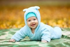 Happy baby boy in autumn park Royalty Free Stock Images