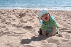 Happy baby boy on the beach Stock Photos