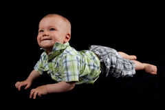 Happy Baby Boy on a Black Background. Little Cute Boy in a Green Shirt Smiling on a Black Isolated Background Royalty Free Stock Photography