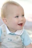 Happy Baby Boy with Blue Eyes Stock Photography