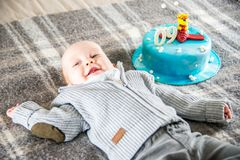 Happy baby boy and cake 9 month Stock Images