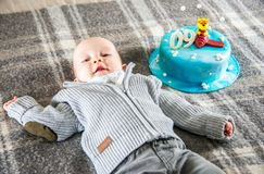 Happy baby boy and cake 9 month Stock Photo