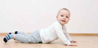 Happy baby boy crawling Stock Images