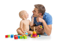 Happy baby boy and dad play together. Happy baby boy and dad playing together Royalty Free Stock Images