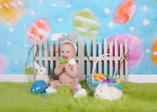 Happy baby boy with easter headband in easter scene Royalty Free Stock Image