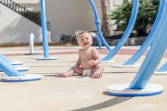 Happy baby boy enjoying playground royalty free stock photo