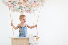 Happy baby boy in a fairy magic hot air balloon. Cute happy baby boy in a fairy magic hot air balloon stock photo
