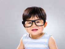 Happy baby boy with glasses Stock Photography