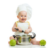 Happy baby boy with green apples Stock Image