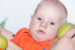 Little baby boy  eating apple Stock Images
