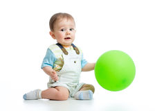 Happy baby boy with green ballon isolated on white Stock Photos