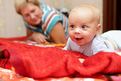Happy baby boy with his grandmother stock photography